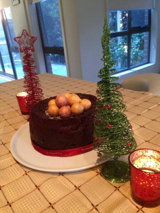 Nigella Lawson's Christmas cake with Tia Maria, cocoa, prunes, currants, raisins and dark muscovado sugar - I topped it with gold dusted chocolate praline balls - this was awesome!