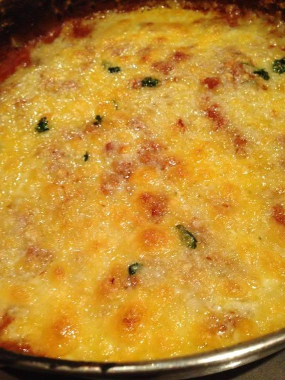 bubbly cheesy goodness with a lava of spicy beans underneath...